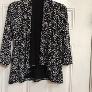 Reversible polka dot and black jacket